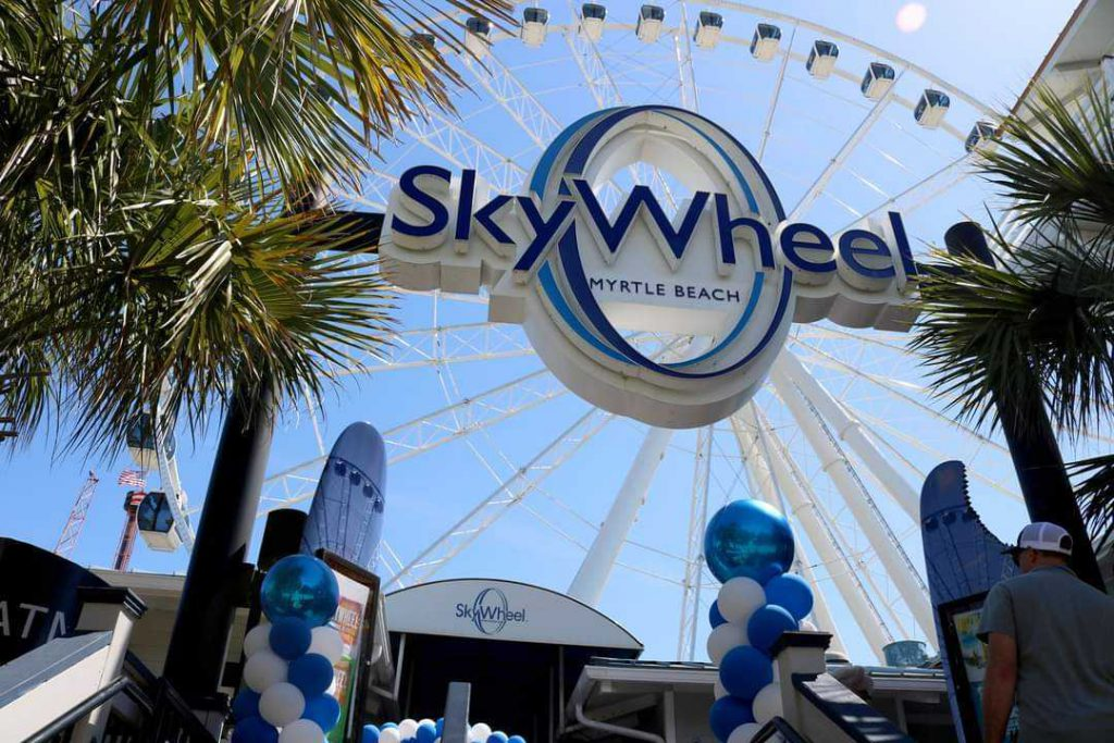 Entrance to Myrtle Beach SkyWheel sign and SkyWheel in background